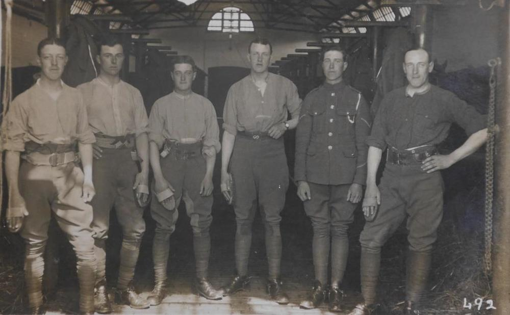 Unnamed photo of First World War date presumed to show six men of the 9th Lancers, including Private John F. Lofts (photographer unknown, but stamped as a postcard on reverse).
