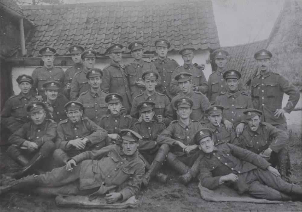 My grandfather, Tom Verrinder, seated second row down far left, with his Troop of the 9th Lancers in France in 1916.  All of these men are privates (the term 'trooper' was not used in Lancer regiments until after the war). The distinctive 9th Lancers cap badge can clearly be seen. Several of the men wear Good Conduct stripes (reverse chevrons on the lower left sleeve), awarded to Privates and Lance-Corporals for at least two years' service without being subject to formal discipline, and showing that these men were pre-war regulars who were with the regiment in 1914. The two men on the right also have the vertical wound stripe on the same sleeve. Since the wound stripe was first authorised by Army Order 206 of 6 July 1916, this gives a  terminus post quem  for the photograph, which was almost certainly taken late in the year as my grandfather was away from the regiment with a dismounted party from the start of the Somme offensive on 1 July for almost five months (photo from my grandfather's collection).