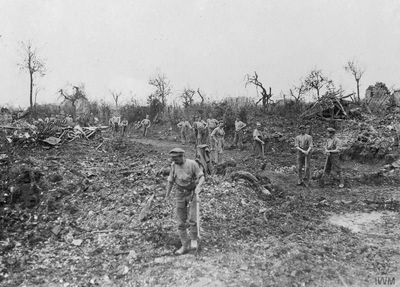 Fricourt, showing British troops clearing away the debris, July 1916 (photo: Royal Engineers No 1 Printing Company, IWM Q 135).