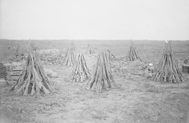 'Salvage collected after the advance', Morval, September 1916. These British Lee-Enfield rifles taken from dead and wounded men would have been among the material 'forwarded to the various dumps' noted in the letter above (photo: Lt John Warwick Brooke, IWM Q 4317).