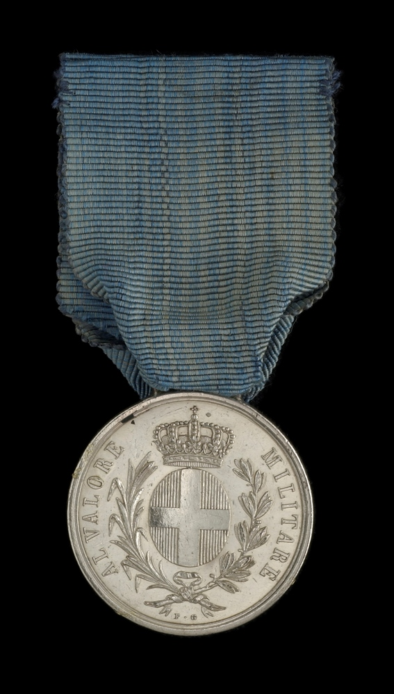 The Sardinian Medal for Valour, from the collection of the National Maritime Museum. This example is fitted with a loop and ribbon as originally issued, but some recipients had theirs refitted privately with a suspension bar and ornate suspension arms more in keeping with the appearance of British medals (as was done with the Turkish Crimea Medal too).
