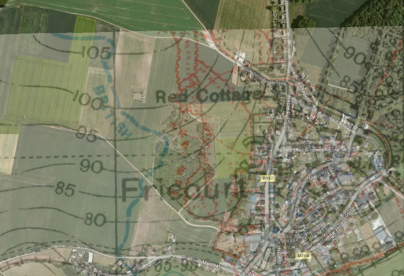 An overlay of the 25 April 1916 British 1:20,000 trench map 62D.NE2 on a satellite image of Fricourt and the fields to the west.  In the centre is no-man's land as it existed before 1 July 1916, with the British front line in blue to the left and the German in red to the right. The red blotches where the lines are closest, between the words Red Cottage and Fricourt, are the 'Tamour mines', the craters of which are still visible in the woodland that covers that part of no-man's land today. Fricourt New Cemetery is in no-man's land to the left of the letter R in Red Cottage; the point where I took the photo holding the artefacts looking back towards the cemetery is at the top left of this image where the lane crosses the continuation of the British front line, not shown here but marked on the adjacent trench map (from the National Library of Scotland  First World War trench maps website .)