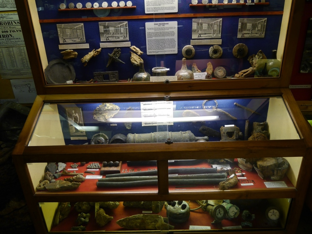 Artefacts from  Primrose  are displayed in the lower part of the upper case and the top shelf of the lower cabinet ( Charlestown Shipwreck and Heritage Centre ). Click to enlarge; see below for close-up views.