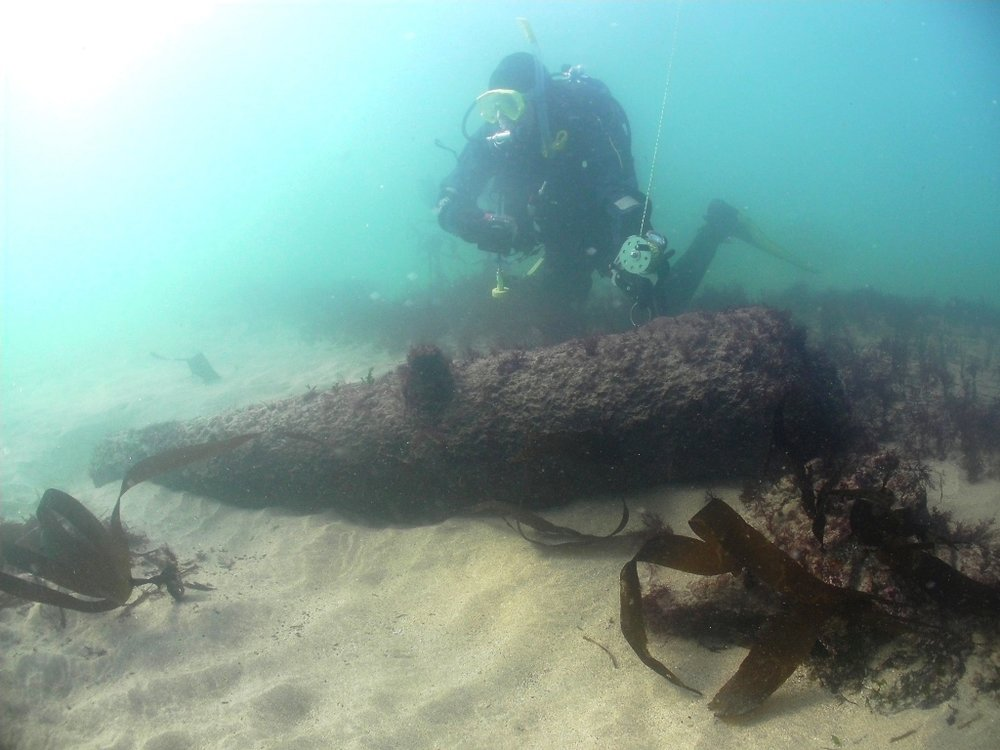 Poldark wreck 1 Archaeologist David Gibbins with gun (photo Mark Milburn).jpg