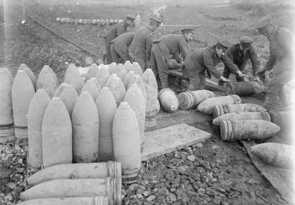 British troops loading 9.2-inch howitzer shells onto a light railway trolley, Fricourt, September 1916 (photo: Lieutenant Ernest Brooks, © IWM (Q 1470)).