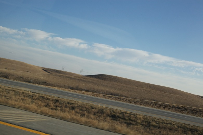 at 75 mph, it's difficult to keep one's horizons straight as one marvels at central Kansas's unexpectedly strange landscape