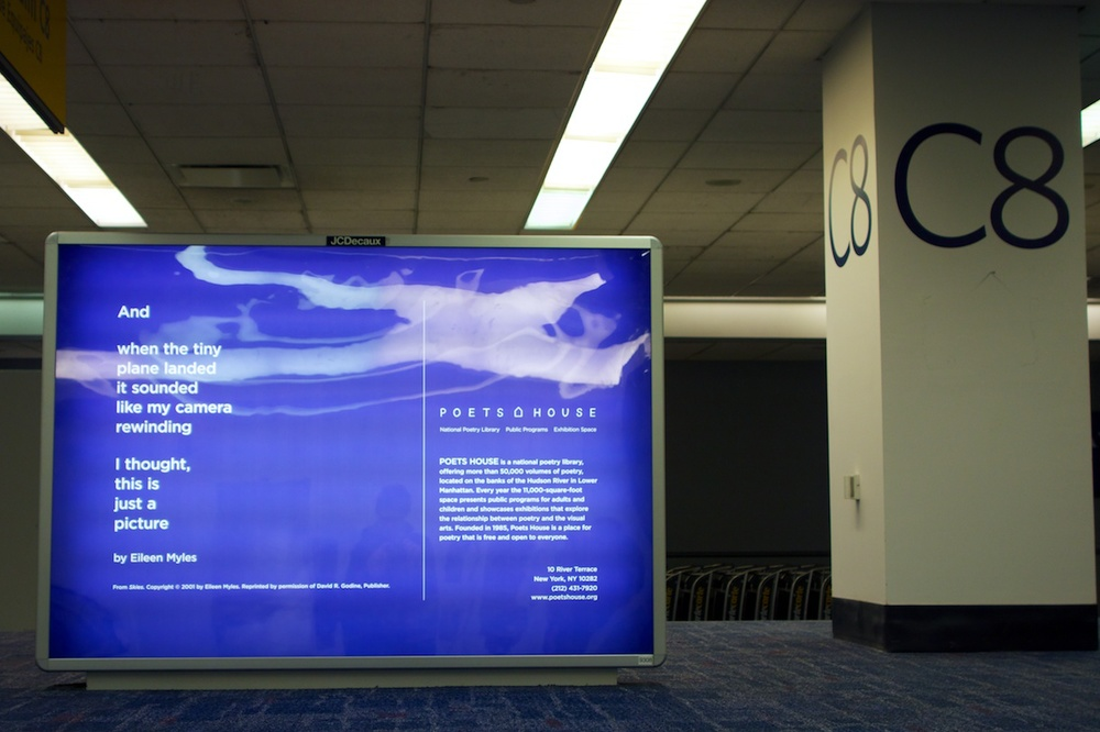 A surprising and completely welcome advertisement for Poets House at my baggage carousel in LaGuardia Airport, 26 December 2013.