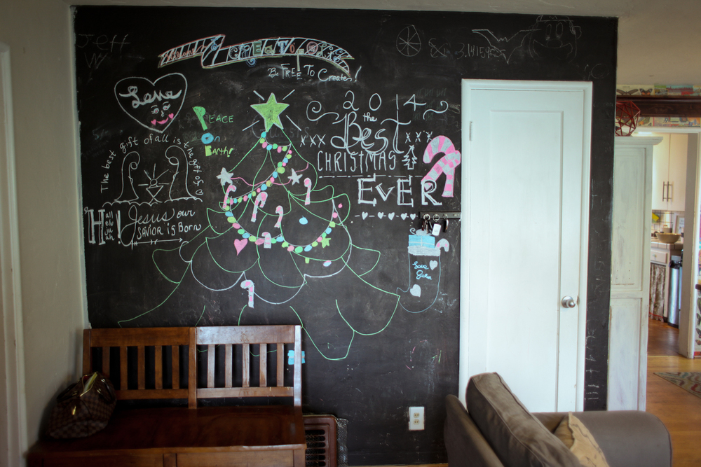 The chalkboard wall is strategically placed in their entrance where the family can be creative and welcome their guests.