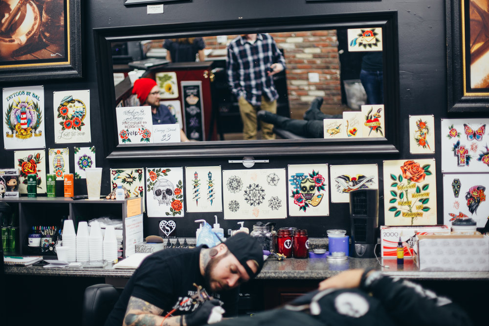 I always love checking out tattooer's stations. The artwork on their wall tells a lot about what kind of artist/person they are.