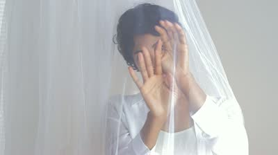 stock-footage-close-up-of-black-woman-behind-sheer-curtains-blowing-in-wind-1.jpg