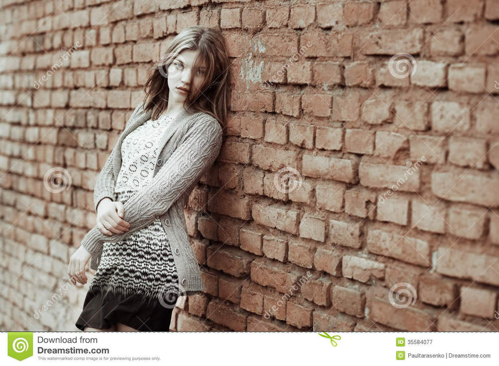 portrait-sad-female-standing-against-wall-outdoor-35584077.jpg