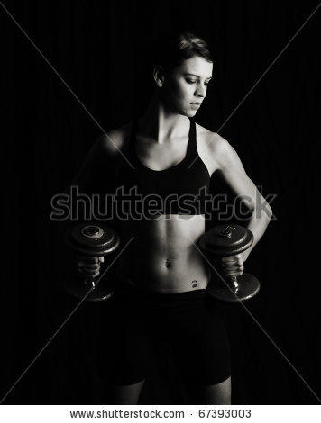 stock-photo-attractive-woman-working-out-low-key-studio-shot-on-black-67393003.jpg