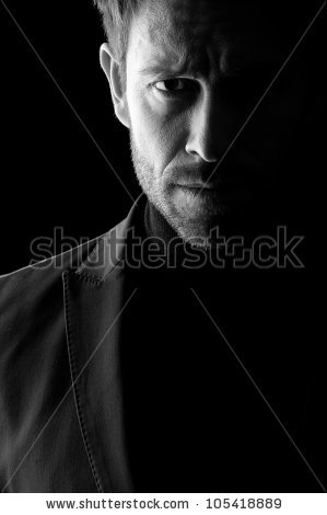 stock-photo-studio-low-key-portrait-in-black-and-white-of-a-mid-age-man-wearing-a-blazer-105418889.jpg