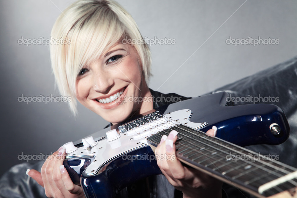 depositphotos_28458475-Blonde-girl-with-an-electric-guitar-on-a-black-couch.jpg