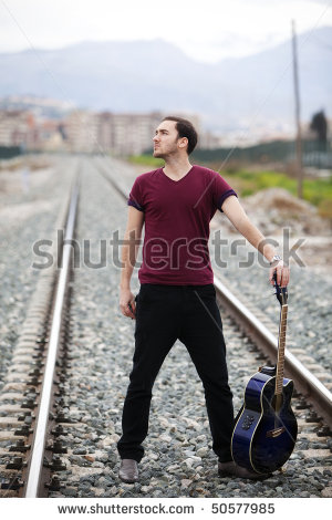 stock-photo-young-male-musician-posing-with-his-acoustic-guitar-50577985.jpg
