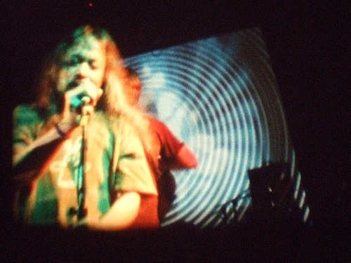 Damo Suzuki performing with The Whole, visuals by Kosmik Klaus and his Solar Sea Slide Show