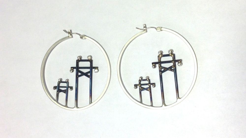 E4 Sellers, Caitie two towers free standing in silver hoop.jpg