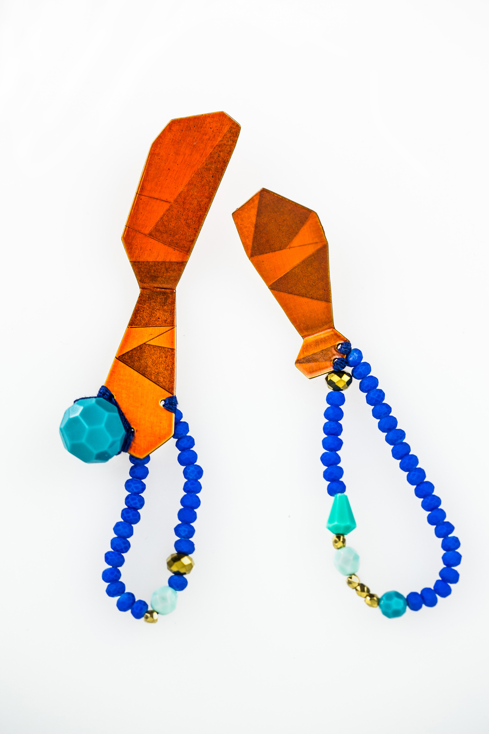 E5 Voegele, Stephanie large orange geometric shape with blue beads.jpg