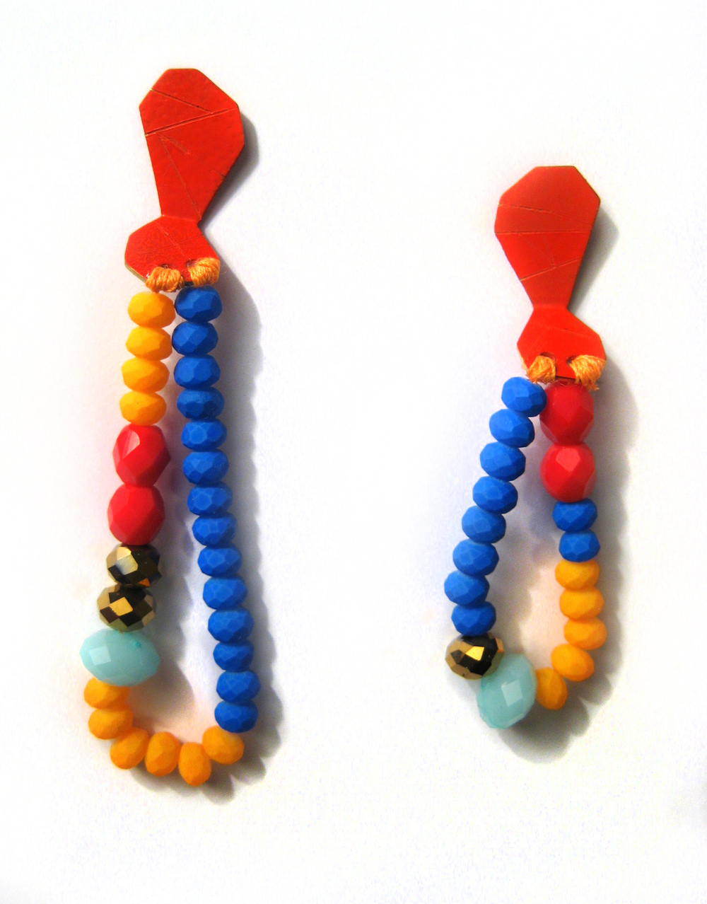 E8 Voegele, Stephanie small orange geometric shape with blue, orange, red & gold beads.jpg