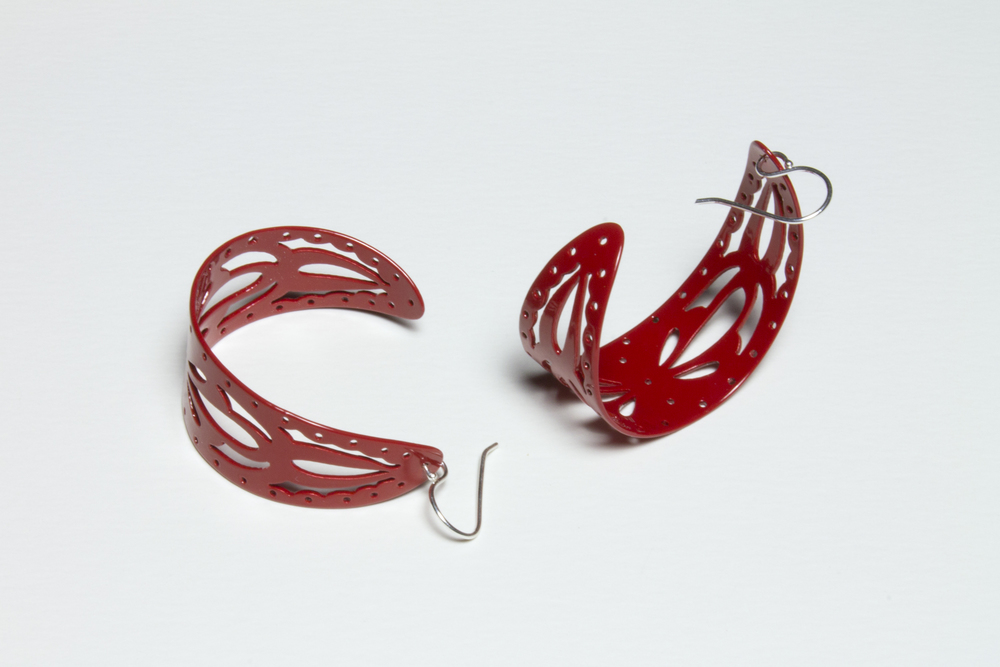 EE32 Buchanan, Ashley red curved cutout half hoops.jpg