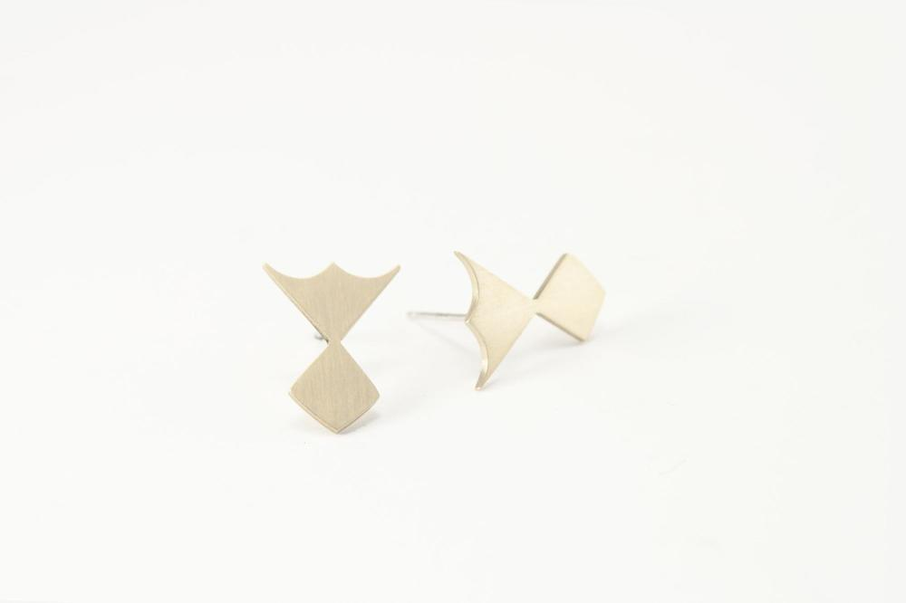 E9 Snell, Lindsey (09) small brass & sterling silver badge, cutout, geometric shape.jpg