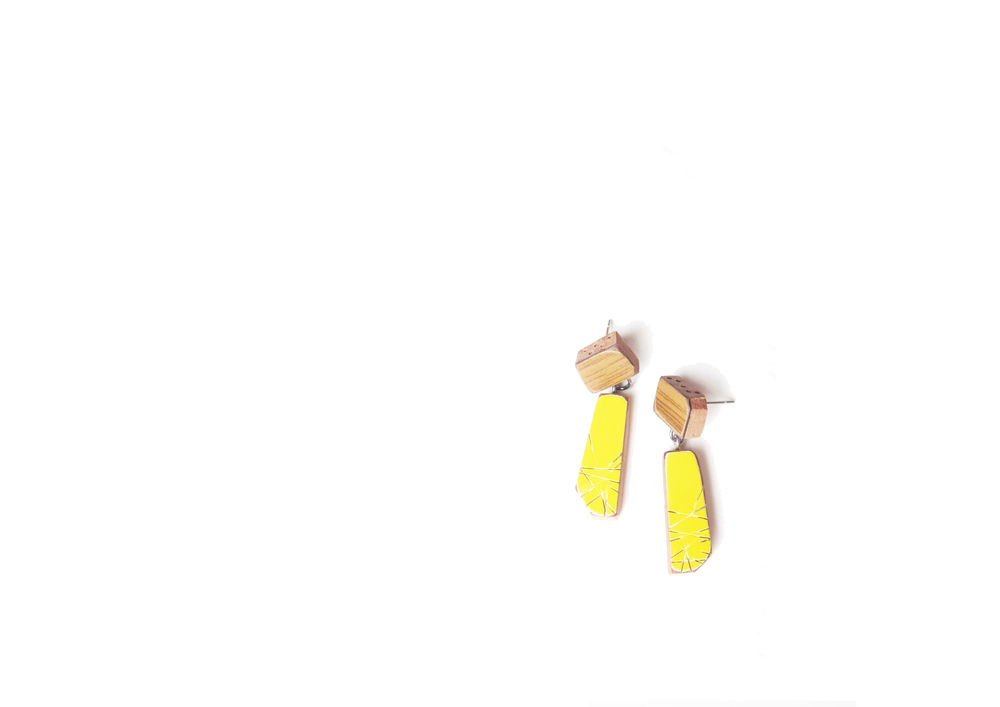 E1 Vanmol, Karen wood on post, yellow rectangle dangle.jpg