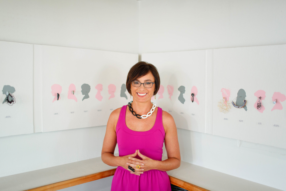 Heidi poses in front of the Earrings Galore 2016 exhibiton at her gallery in Rehoboth Beach. Photo by Maria DeForest