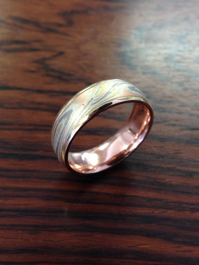 Mokume Gane Gents Wedding Band Custom Made in White Gold, Yellow Gold, Rose Gold and Silver with Rose Gold Liner and Yellow Gold Rails Acid Etched.