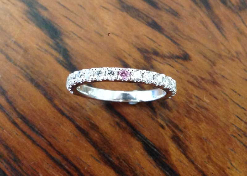 Platinum Micro Pave Diamond band 3/4 set with one centre pink Argyle Diamond