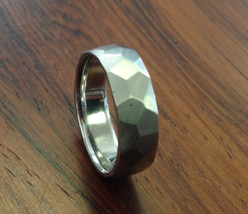 Gents Palladium Wedding band. The client is an architect and found triangles inspired him! A brushed finish and really cool wedding band.