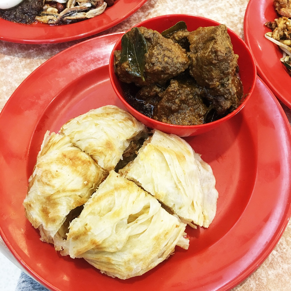Roti Canai with Curry Beef - The roti dipped in curry and the softened down beef hit the spot!