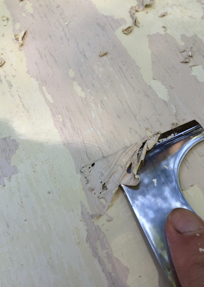 The softened paint scrapes of easily.