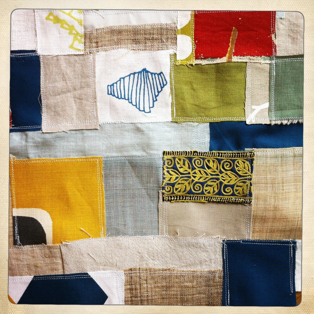 rough textile collage in greens and blues