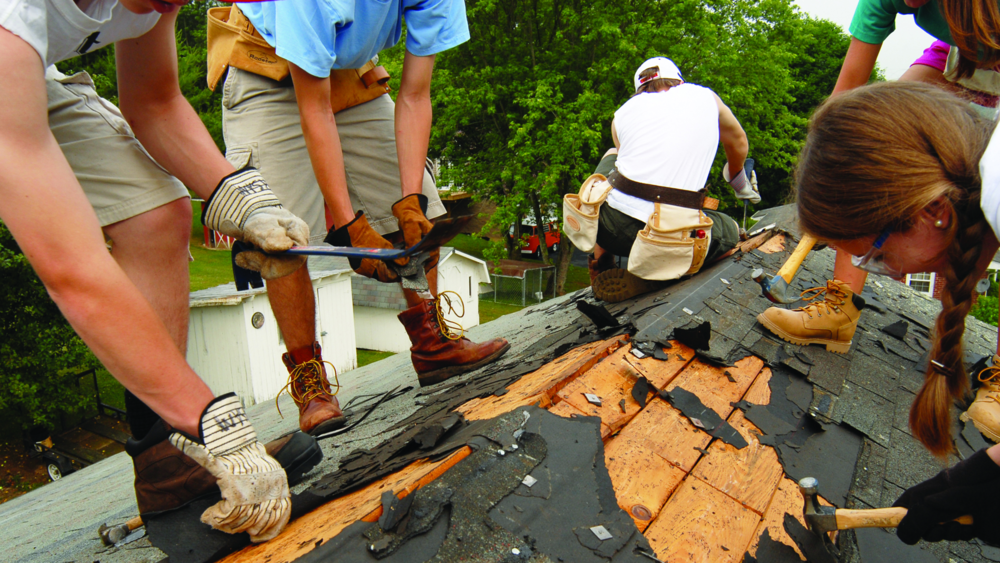 A Service Project Team Repairs a Roof
