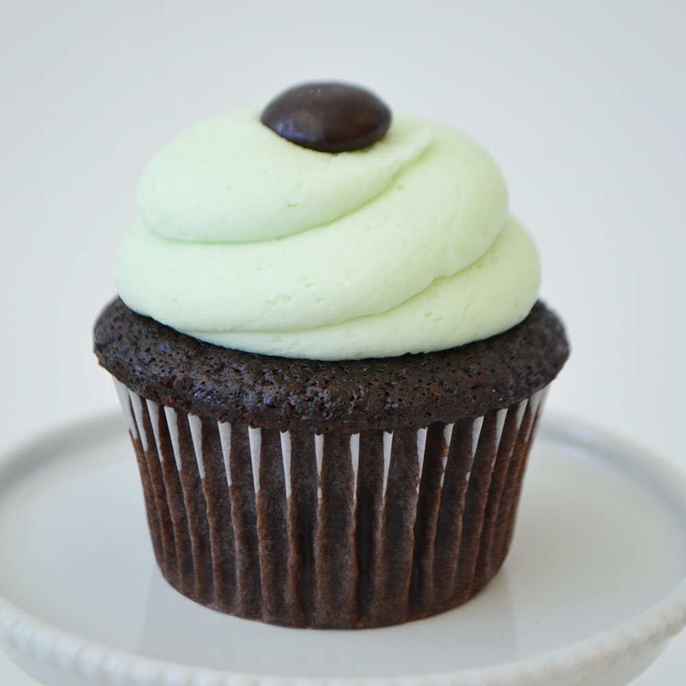 Chocolate Mint Cupcake  - Moist chocolate cake topped with mint buttercream icing and a Junior Mint.