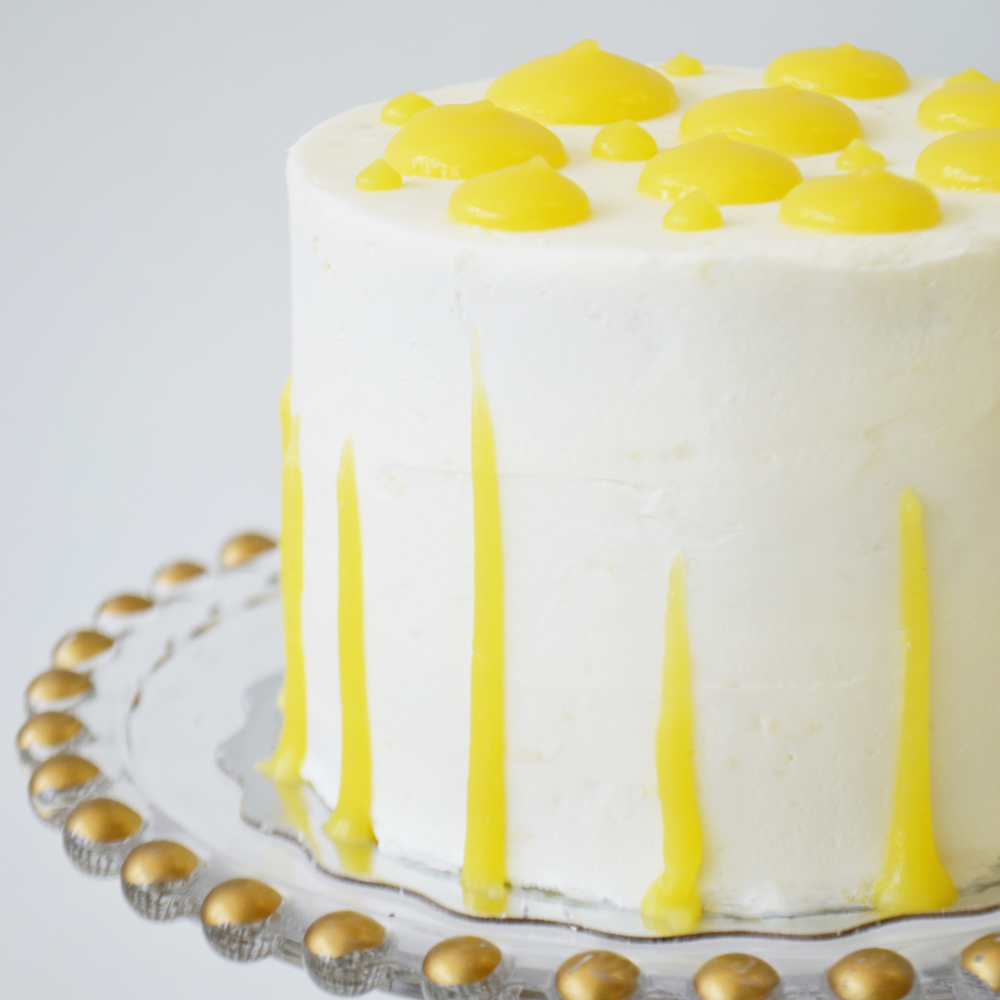Lemon Cake  - Three layers of dense vanilla cake filled with lemon curd and lemon buttercream.