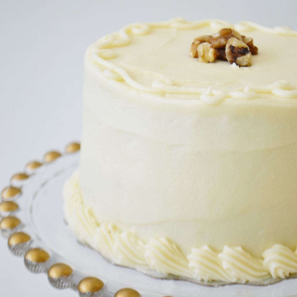 Carrot Cake - Lightly spiced carrot cake with walnuts layered with cream cheese icing.