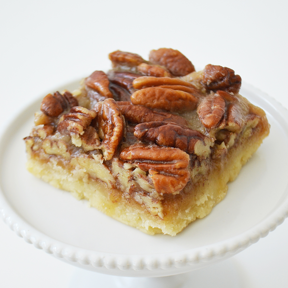 Pecan Square - Shortbread crust topped with caramel & pecans.