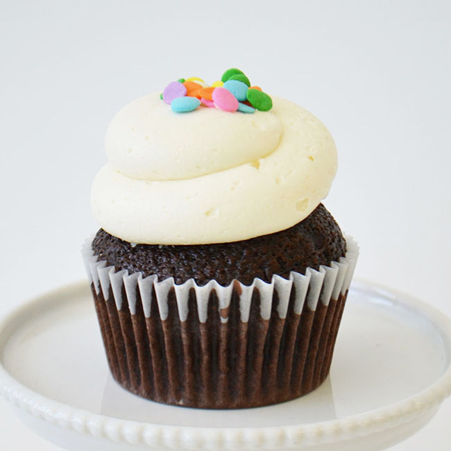 Chocolate Vanilla Cupcake - Moist chocolate cake topped with vanilla buttercream and confetti sprinkles.