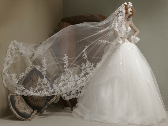 St. Pucchi Couture style 9405  When it comes to wedding veils, this handmade St. Pucchi veil screams drama. In this case, the gorgeous trim on the veil beautifully compliments the tulle ballgown.