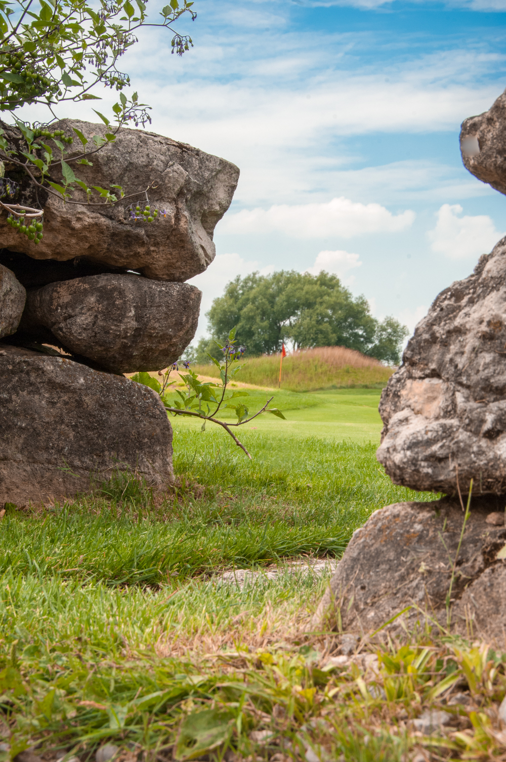 A peek at the flag between the signature fieldstone walls of Heathlands #13