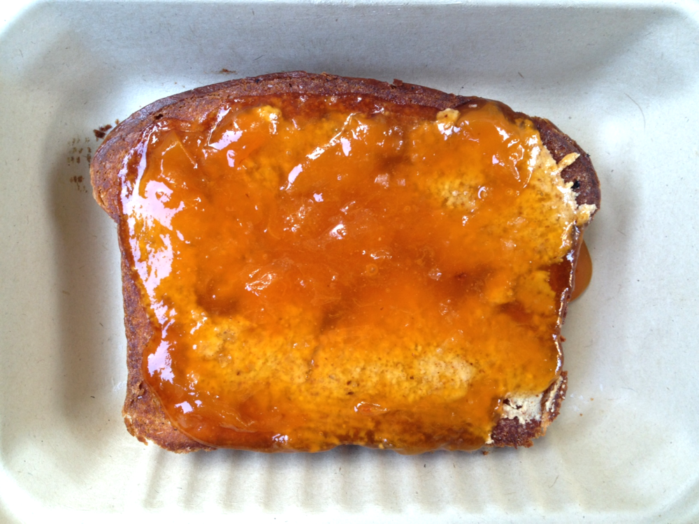 Brioche toast with Blenheim Apricot preserves and nut butter, to-go.