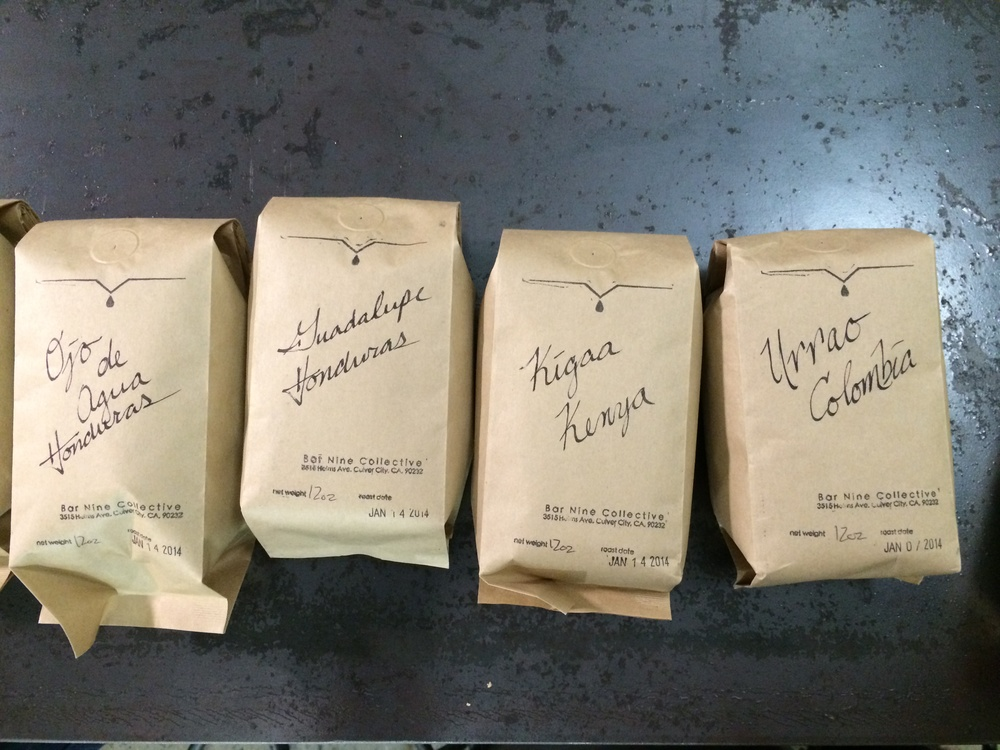 Hand calligraphed bags of beans.