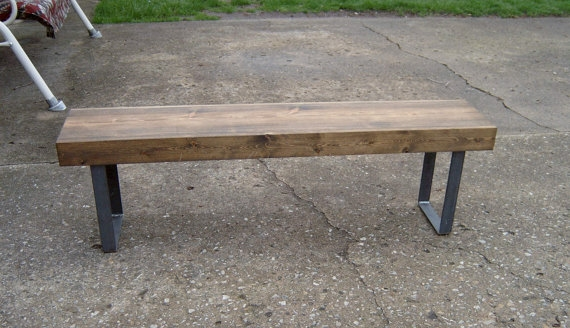 Minimalistic simplicity and really affordable, which is sort of important right now! Dark walnut bench with steel legs from Wayne's Woodworking on ETSY,