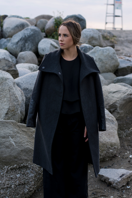 Jordan wears the Istanbul top and the Ella pants, draped in the Caroline coat.