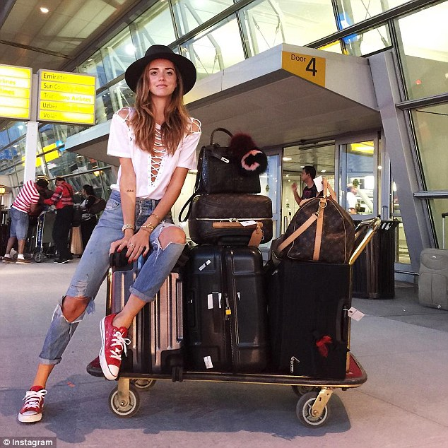 Too much baggage: Style bloggers, including The Blonde Salad's Chiara Ferragni, are traveling the world for Fashion Month with obscene amounts of luggage