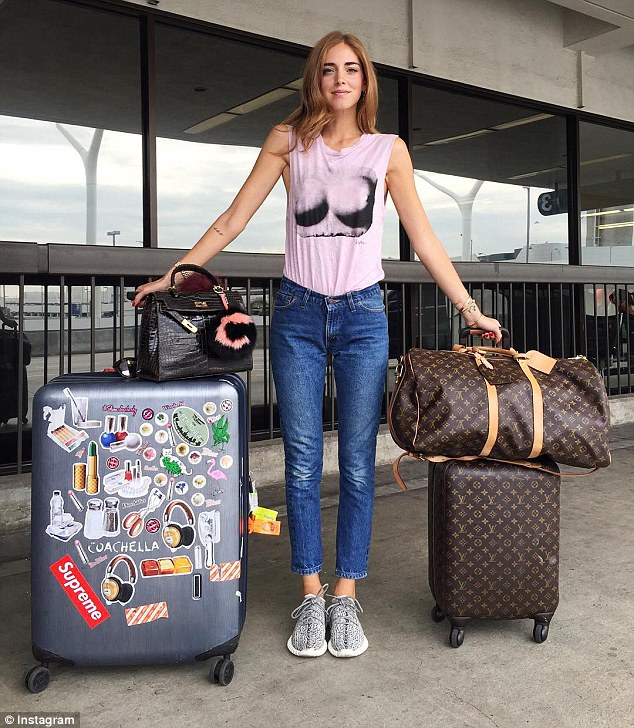 Not packing light: Chiara, 28, is seen standing next to her bags as she jets from Los Angeles to New York for NYFW