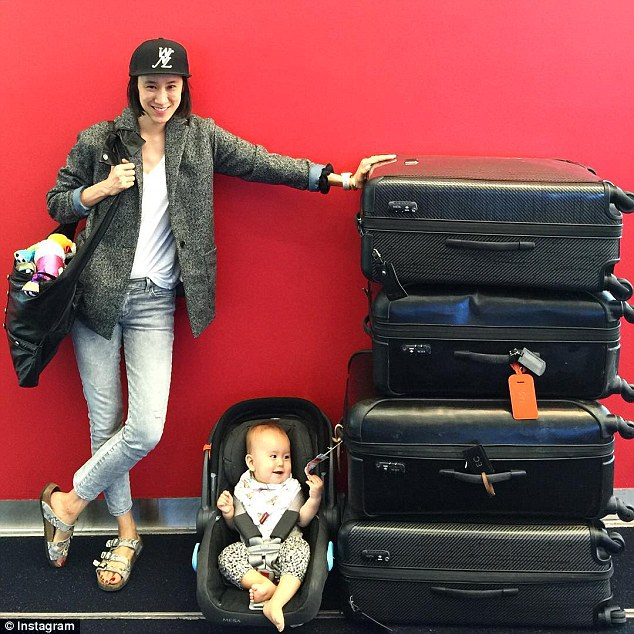 Leaning tower of luggage: Eva Chen, 33, posted this amusing snap of her baby daughter Ren seated next to her tower of suitcases