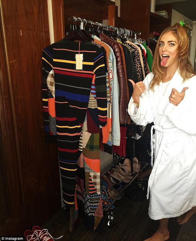 Outfit change: Chiara poses in front of rack of different ensemble choices as she decides what to wear to New York Fashion Week