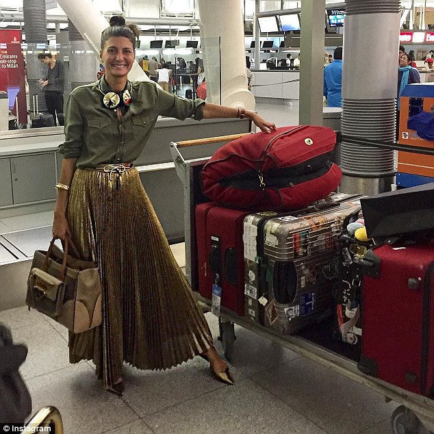 Always on-point: Giovanna Battaglia, stylist and editor of Vogue Japan, looks chic even while schlepping her massive amount of luggage
